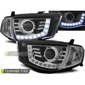 Koplamp set Mitsubishi L200 06-10 Daylight Zwart